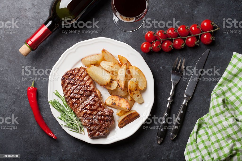 Grilled striploin steak and wine stock photo