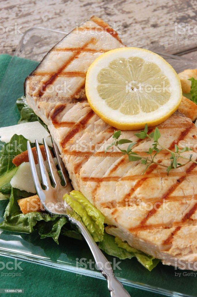 Grilled Swordfish Caesar Salad stock photo