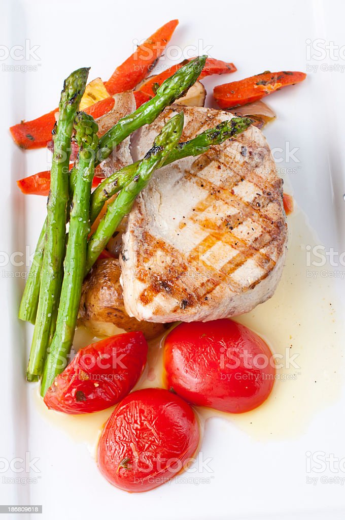 Grilled swordfish with tomatoes and asparagus stock photo