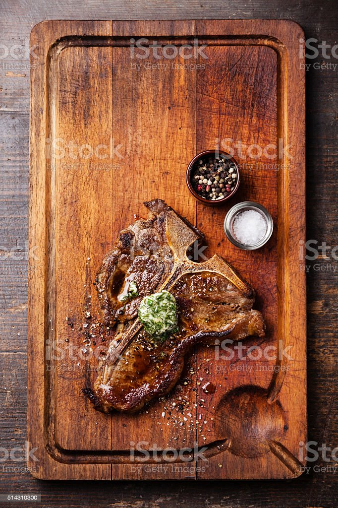 Grilled T-Bone Steak with herb butter stock photo