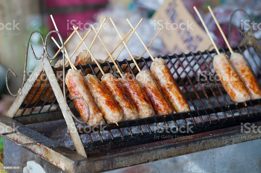 Grilled Thai sausages on the stove in stall beside street stock photo