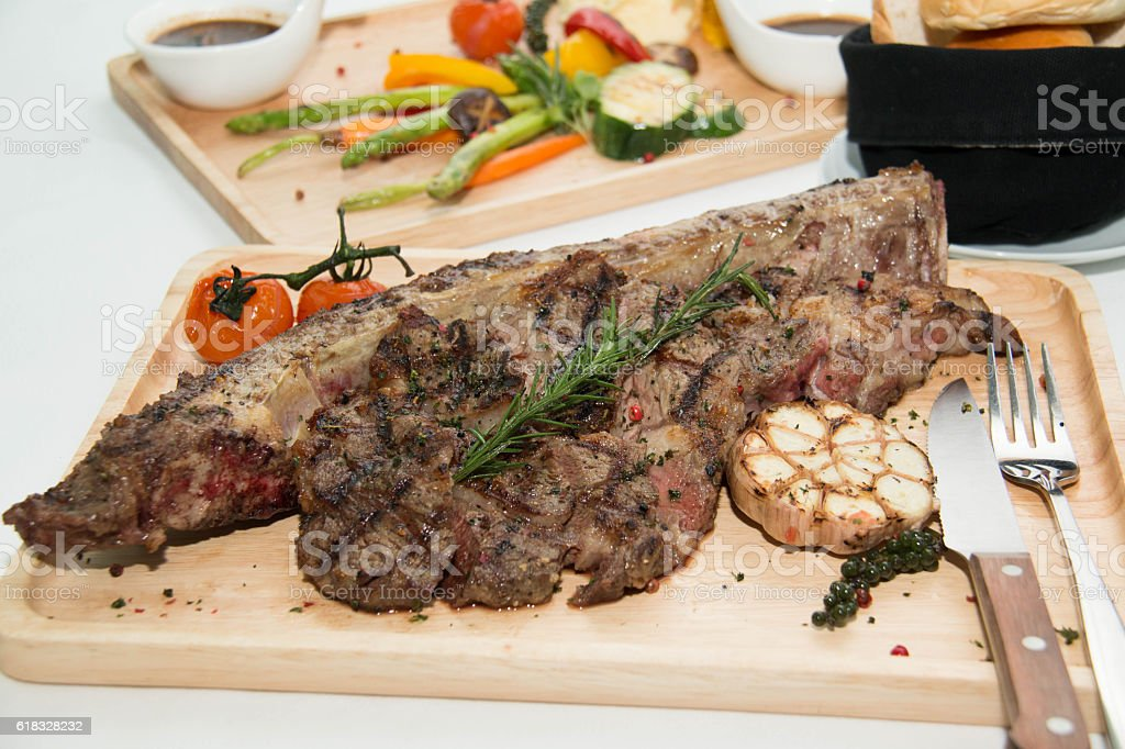 grilled  tomahawk beef steak cut  with fresh rosemary and tomat stock photo