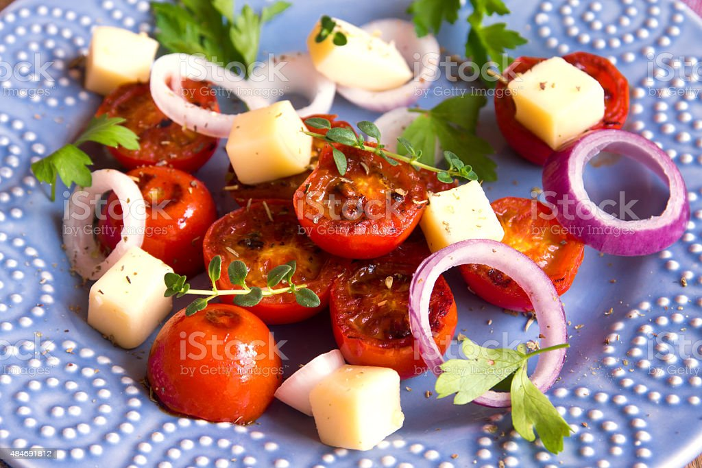 grilled tomatoes, cheese salad stock photo