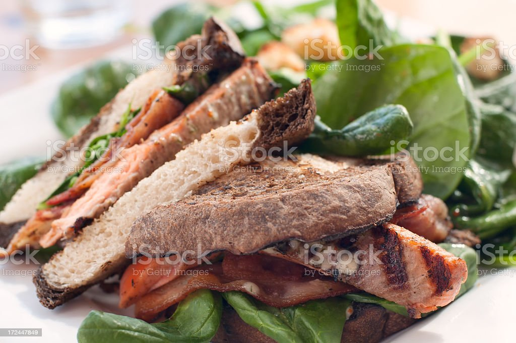 Grilled Trout Sandwich with Bacon, Spinach and Tomato stock photo