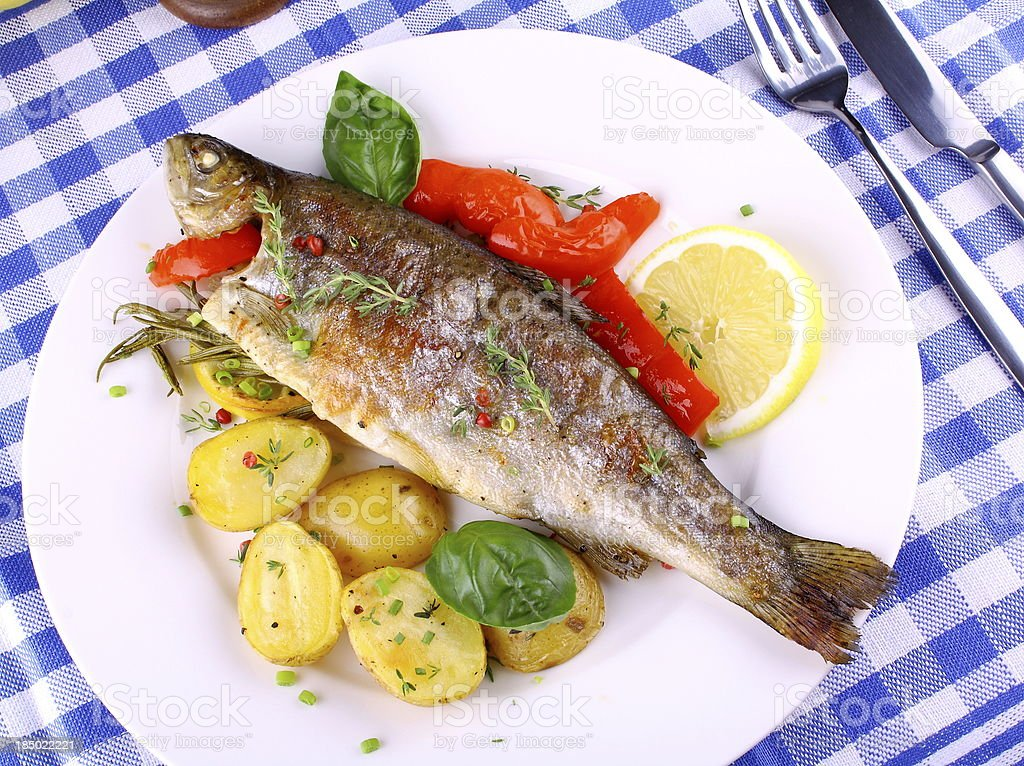 Grilled trout with red pepper, rosemary and potato royalty-free stock photo