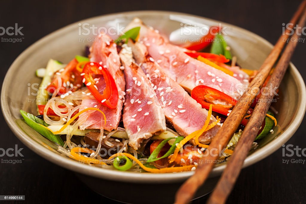 Grilled tuna and  asian rice glass noodles with vegetables stock photo