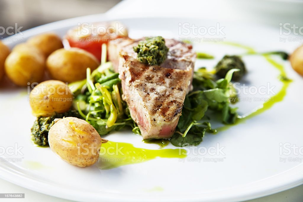 grilled tuna on herbs stock photo