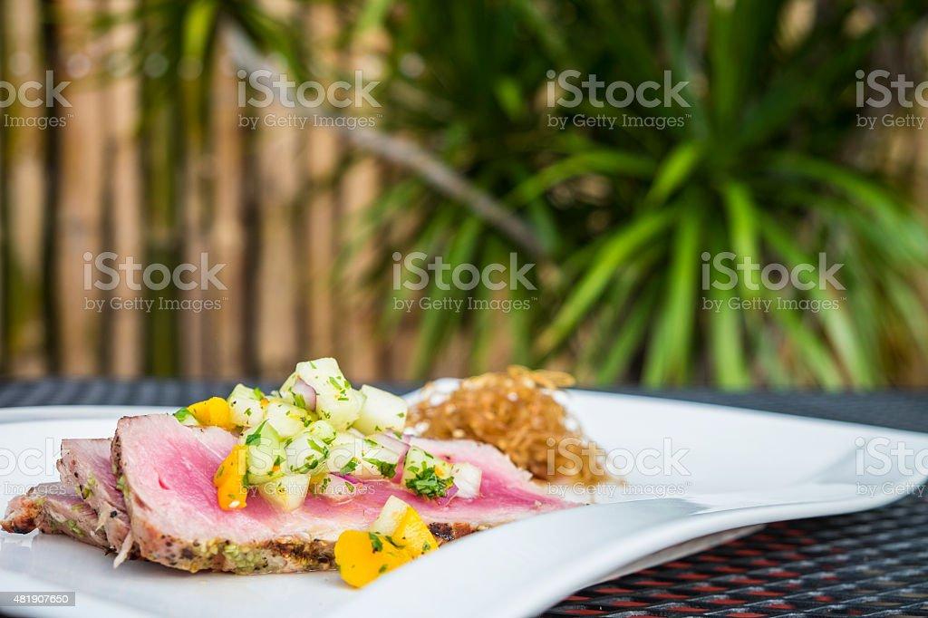 Grilled tuna steak slices with mango-melon salsa stock photo