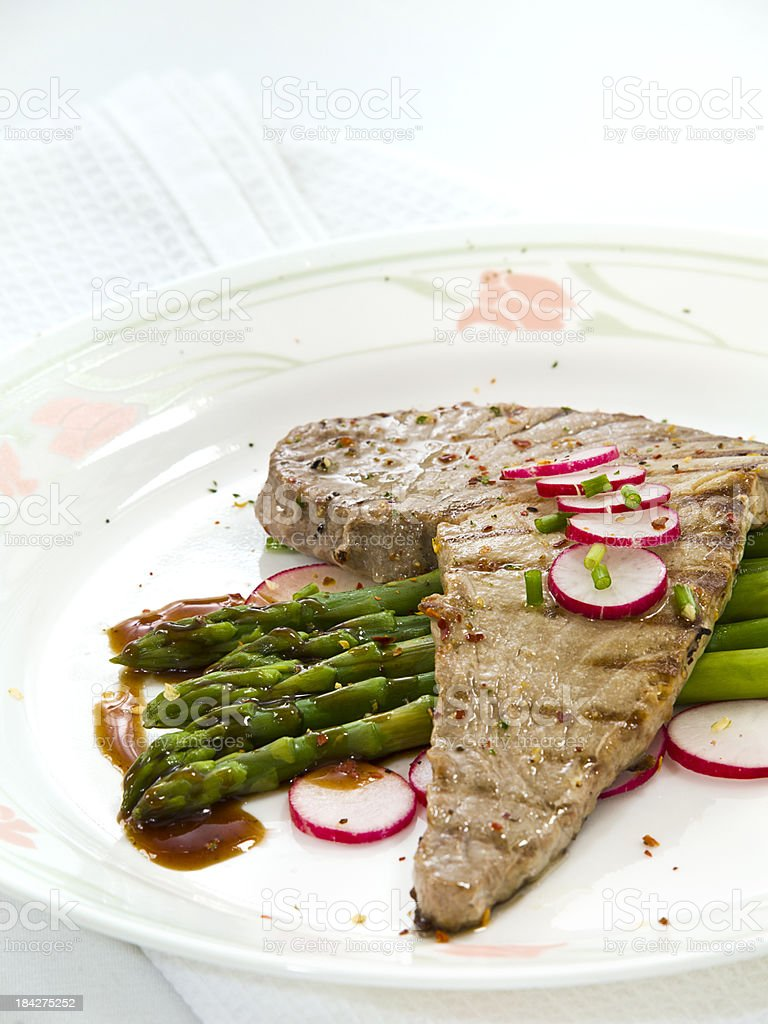 Grilled tuna steak with asparagus royalty-free stock photo