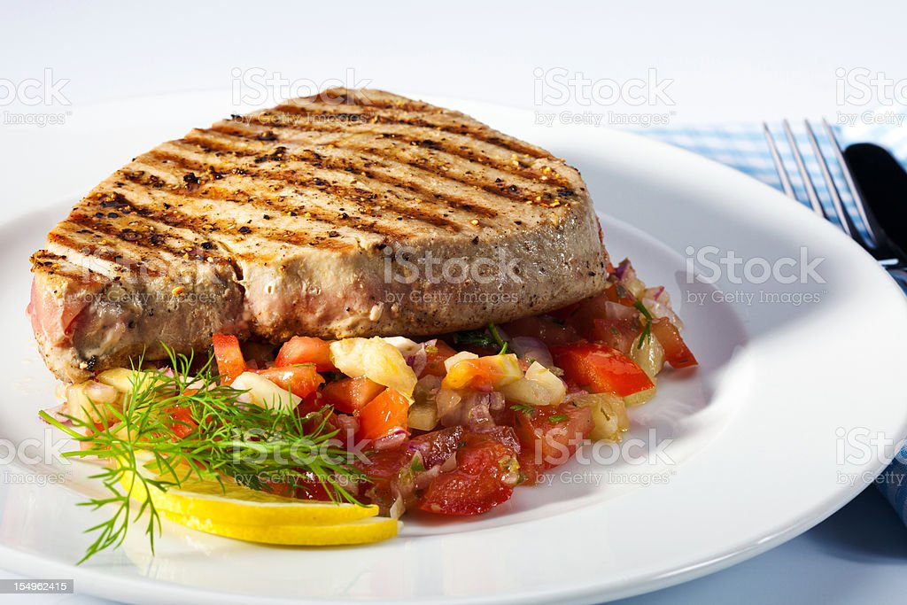 Grilled tuna steak with salad stock photo