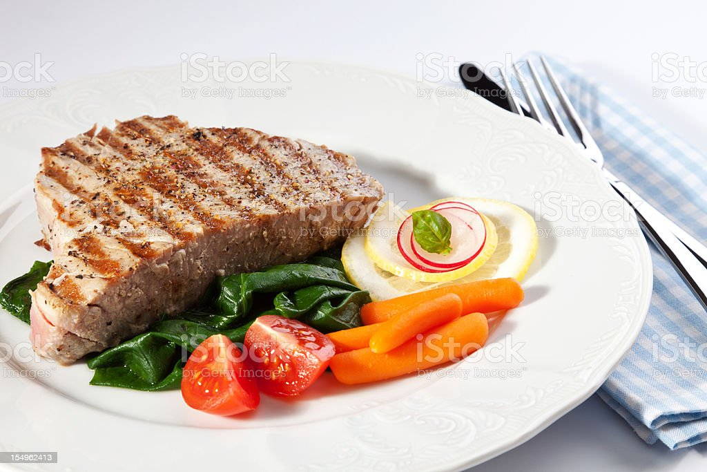 Grilled tuna steak with vegetable stock photo