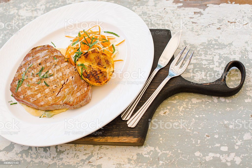 Grilled tuna steak with vegetable salad and polenta stock photo