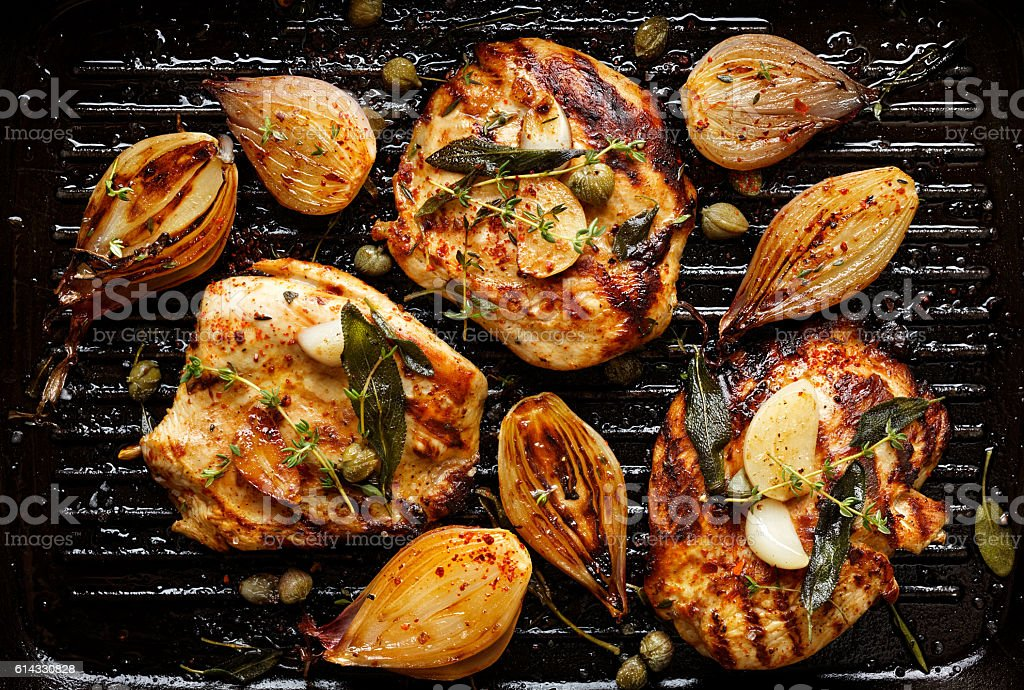 Grilled turkey fillet steak with addition herbs and shallot onions stock photo