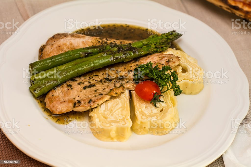 Grilled turkey fillet with asparagus and dumplings stock photo