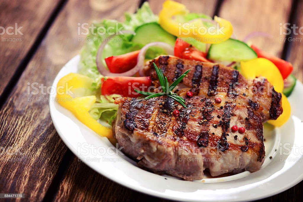 Grilled veal entrecote with salad stock photo