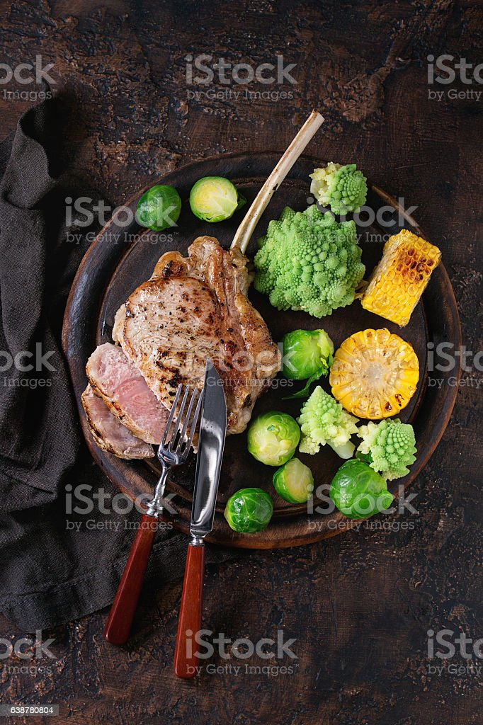 Grilled veal steak with vegetables stock photo