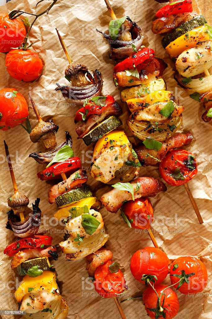 Grilled vegetable and meat skewers stock photo
