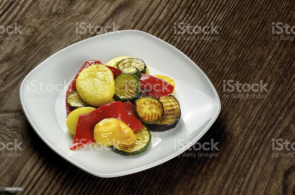 Grilled vegetables on a old wooden table royalty-free stock photo