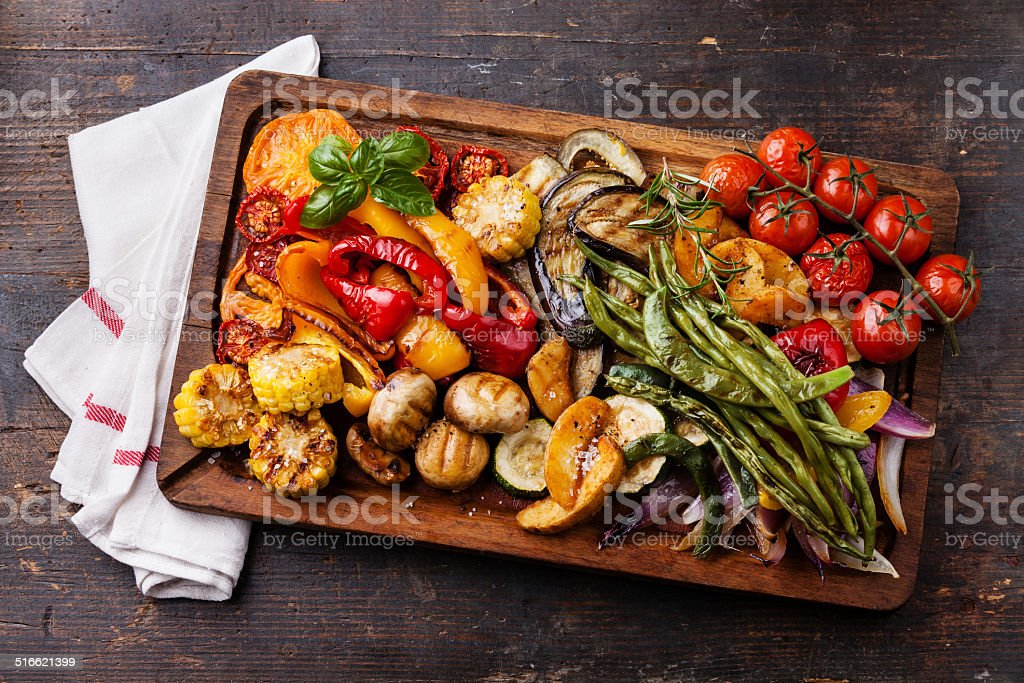 Grilled vegetables on cutting board stock photo