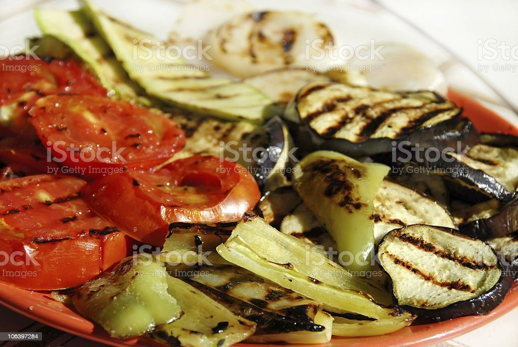 Grilled vegetables on red plate stock photo