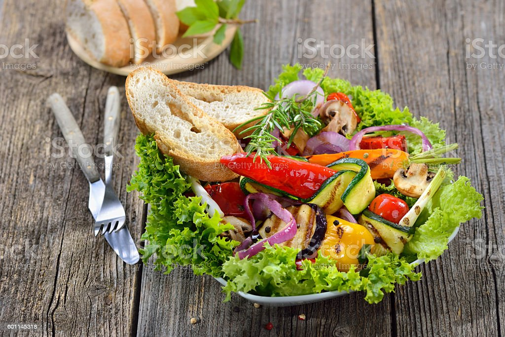 Grilled vegetables on salad stock photo