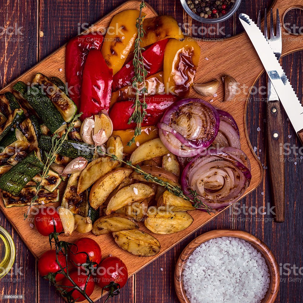 Grilled vegetables served on cutting board stock photo