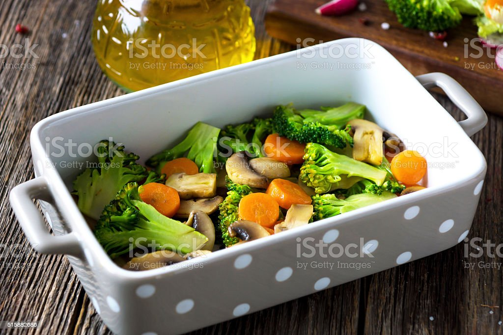 Grilled vegetables with olive oil on wooden background stock photo