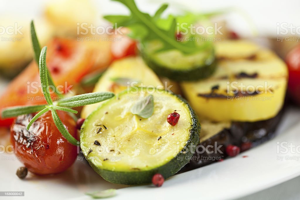 Grilled vegetables with pink pepper and rosemary stock photo
