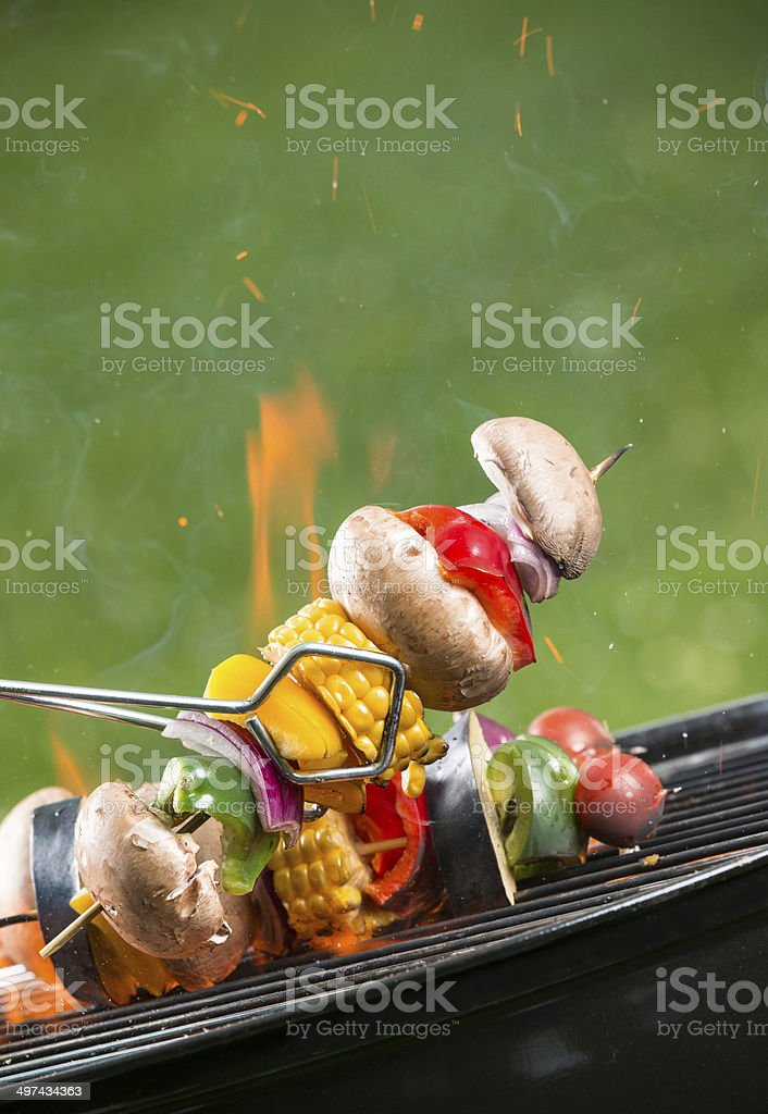 Grilled vegetarian skewers on fire stock photo