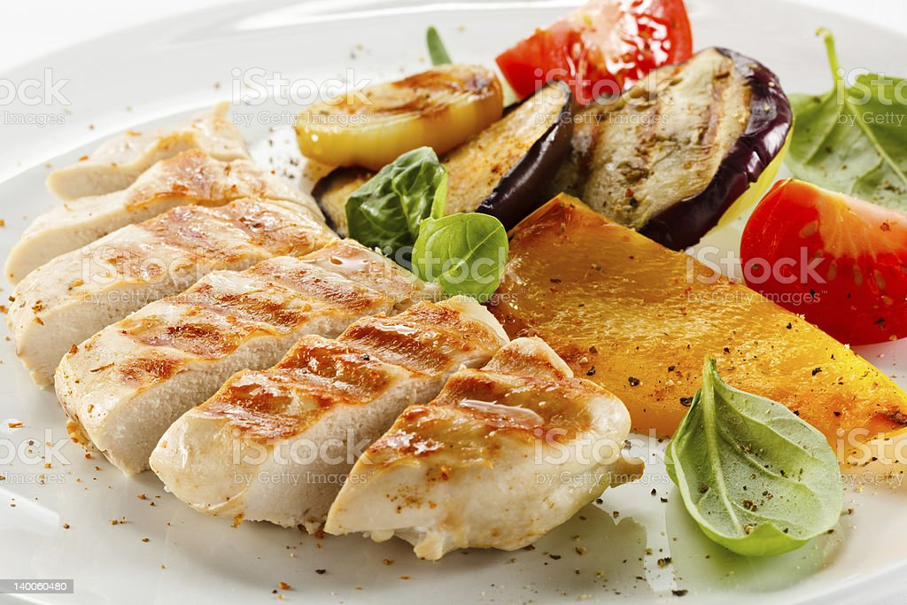 Grilled white meat and vegetables stock photo