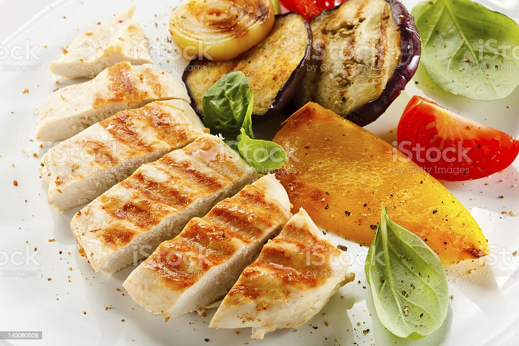 Grilled white meat and vegetables royalty-free stock photo