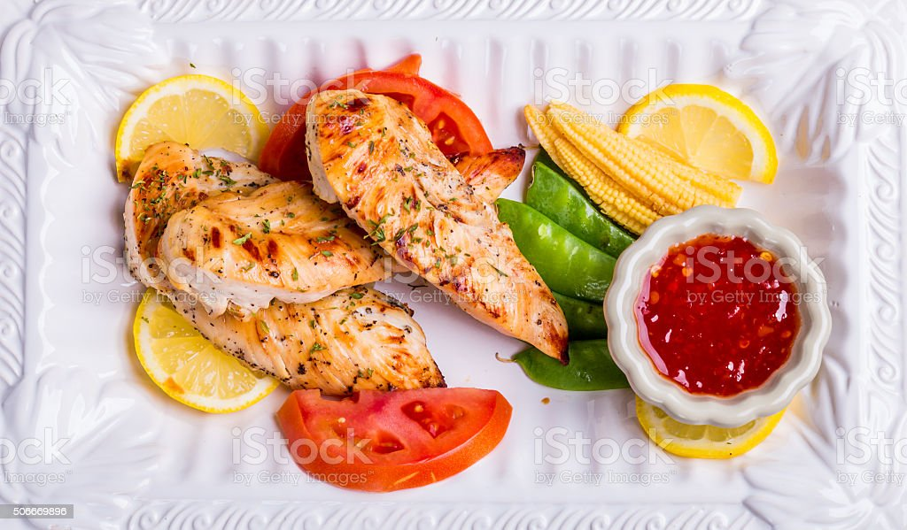grilled white meat chicken breast, chicken strips stock photo
