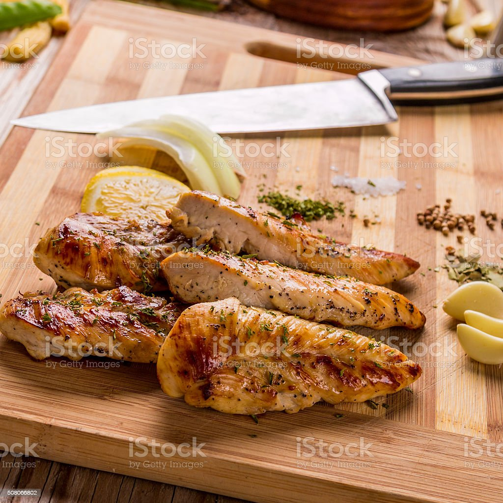 grilled white meat chicken breast, chicken strips stock photo