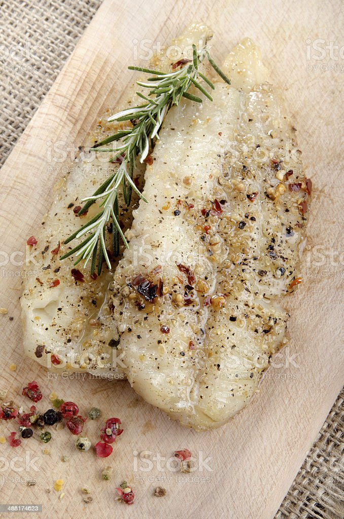 grilled whiting fillet with pepper stock photo