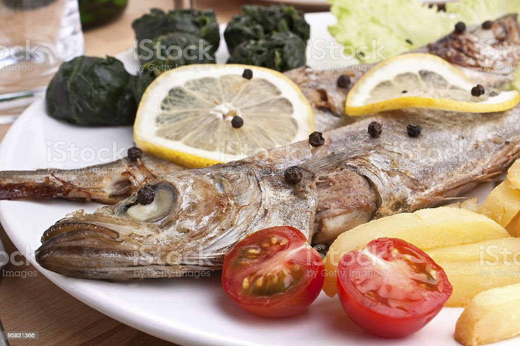 grilled whiting with spinach stock photo