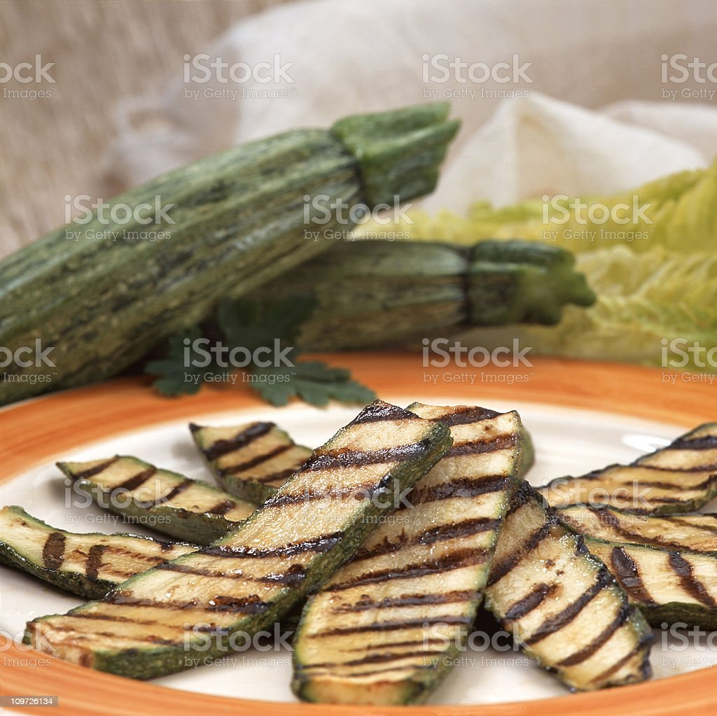 Grilled zucchini on plate stock photo
