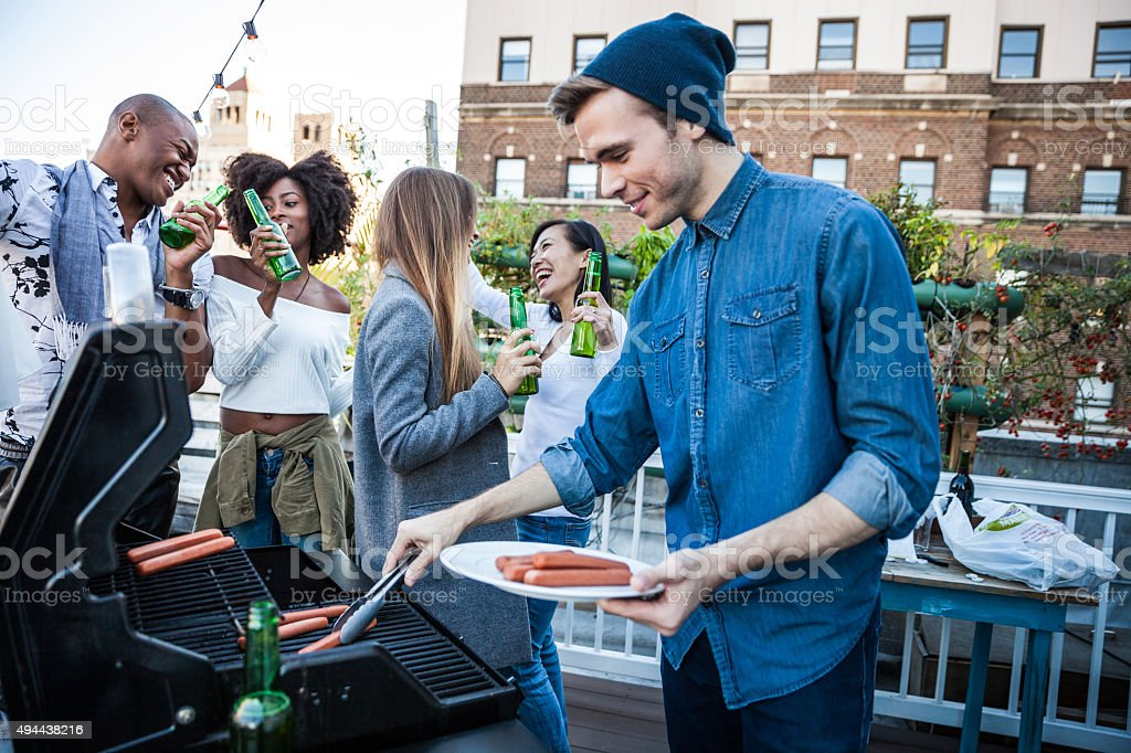 Grilling at the rooftop party in New York Manhattan stock photo