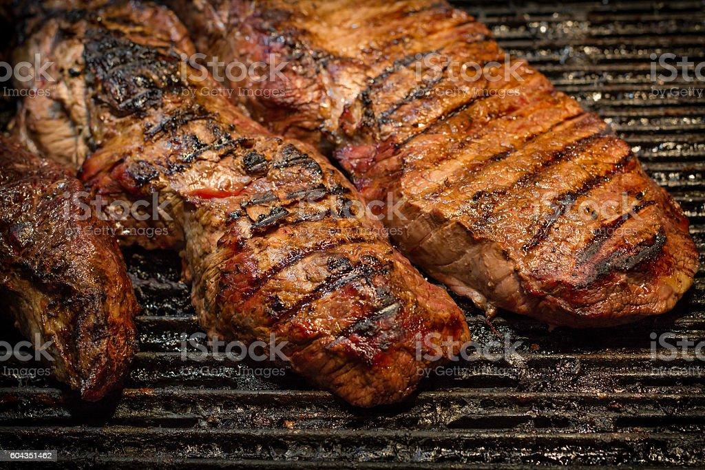 Grilling Beef Steak stock photo