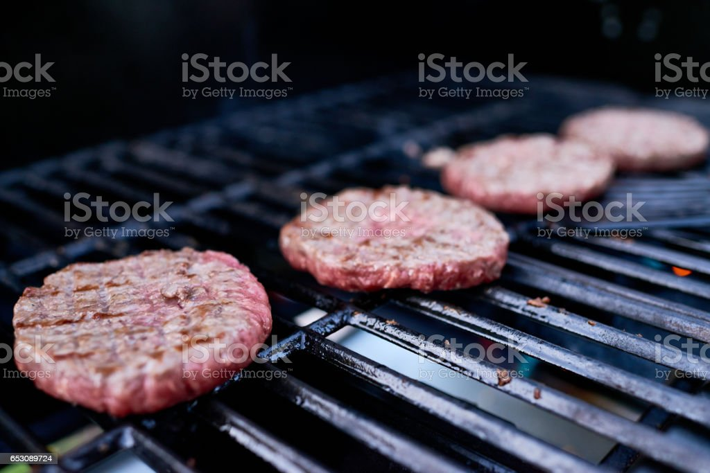 Grilling burgers stock photo