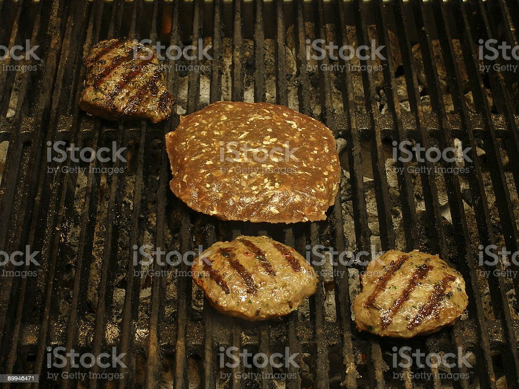 Grilling burgers royalty-free stock photo