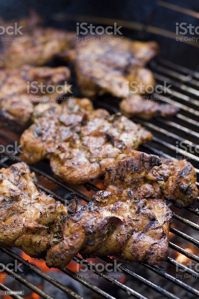 Grilling Chicken on a BBQ royalty-free stock photo