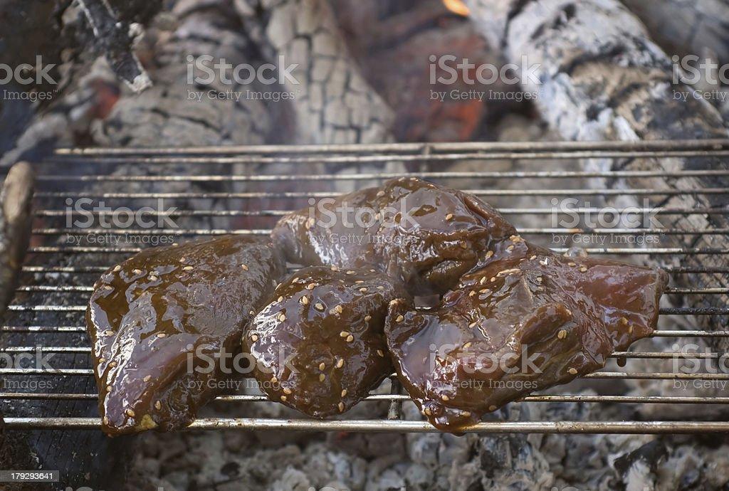 Grilling Elk Steak Over Open Campfire stock photo