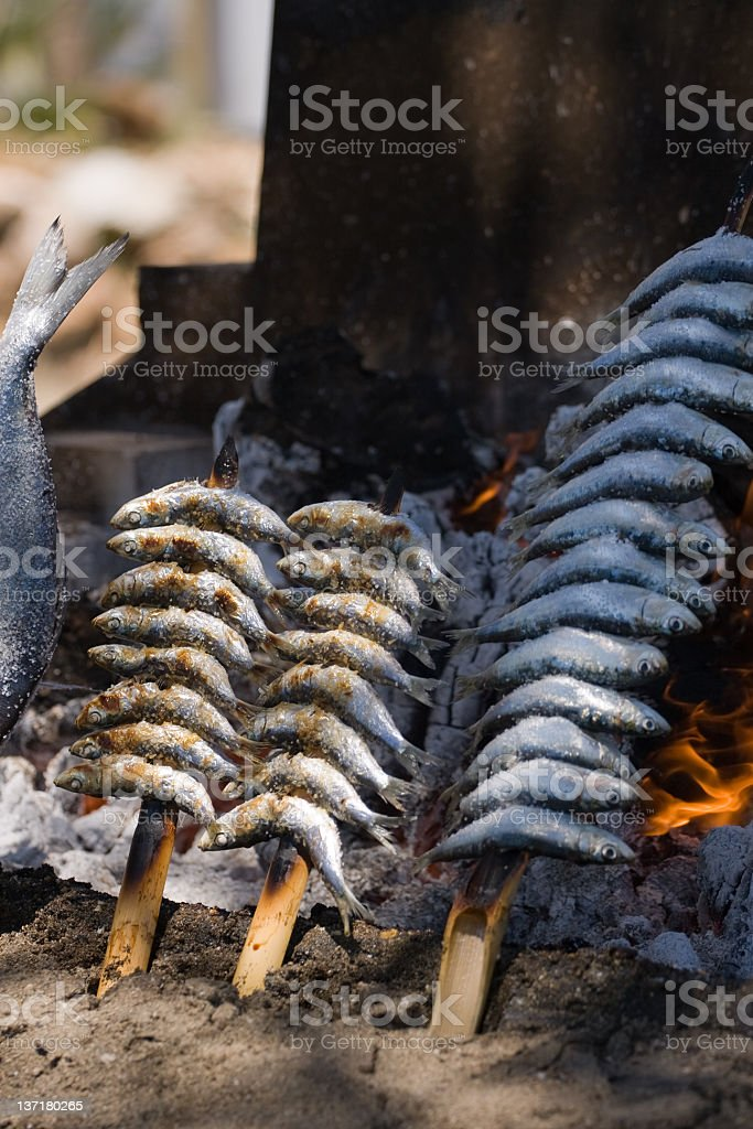 Grilling fresh sardines cooked on the Marbella's beach. royalty-free stock photo