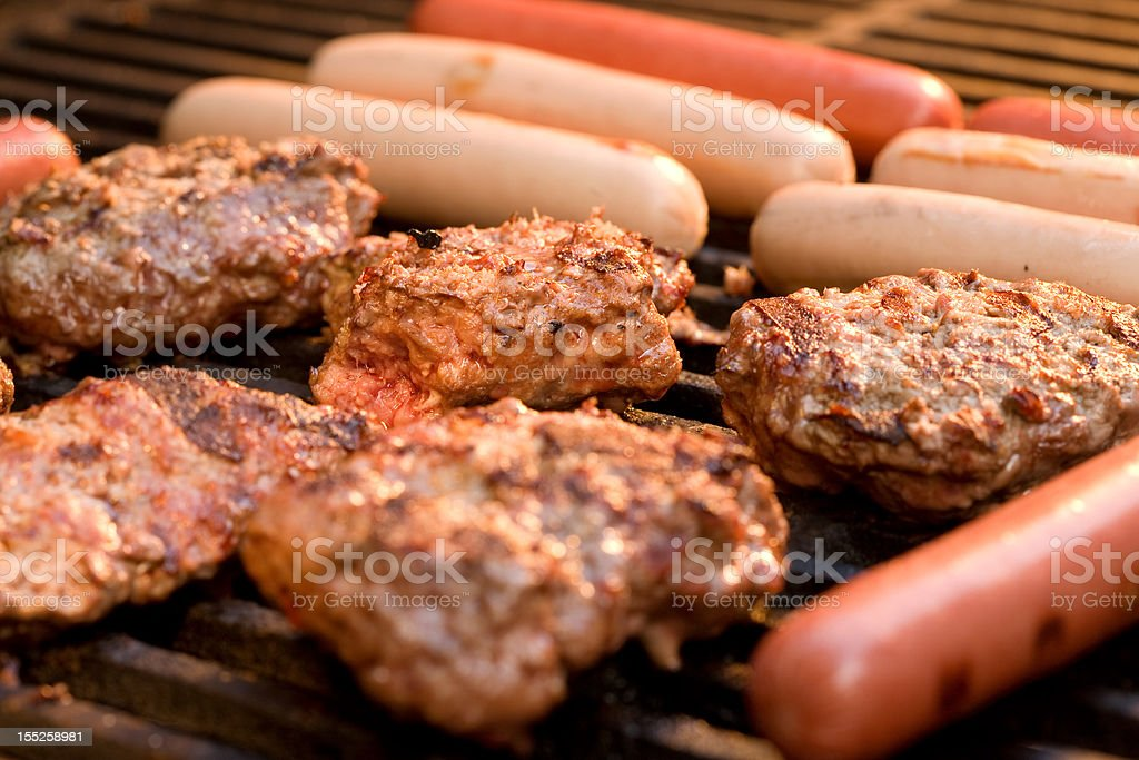 Grilling Hamburgers and Hot dogs royalty-free stock photo
