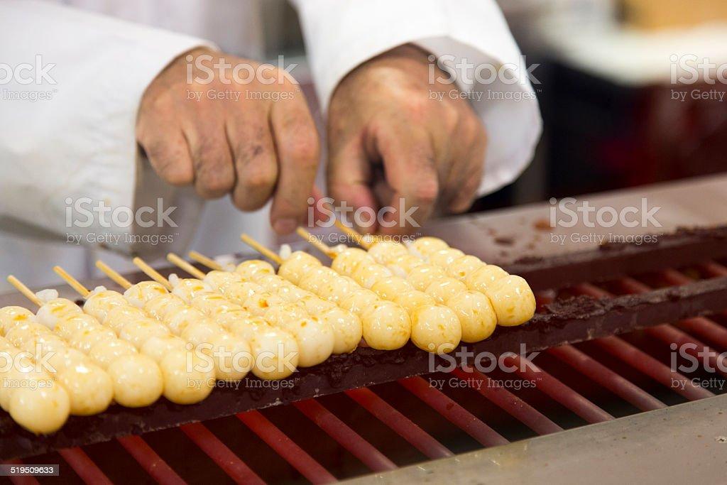 Grilling Japanese Dango stock photo