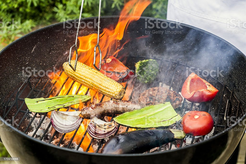Grilling meat and vegetables royalty-free stock photo