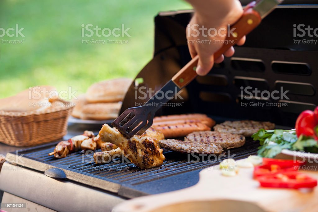 Grilling meat with buns and vegetables stock photo