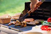 Grilling meat with buns and vegetables