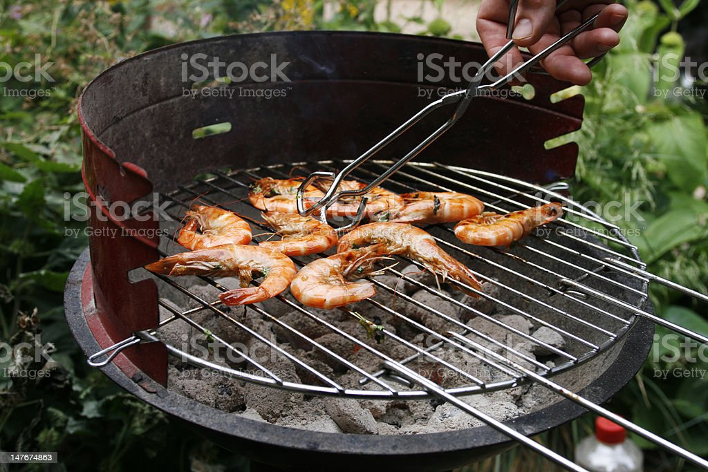 Grilling prawns on a barbecue royalty-free stock photo