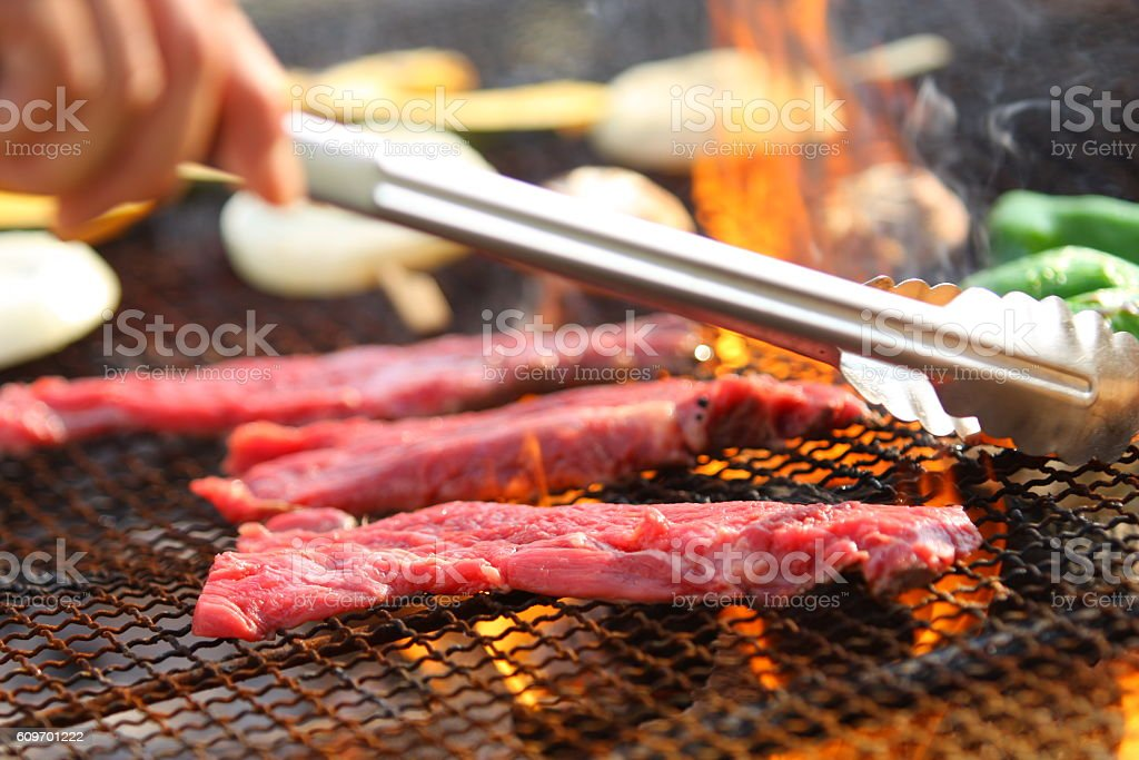 Grilling red fresh beef on hot charcoal in restaurant stock photo